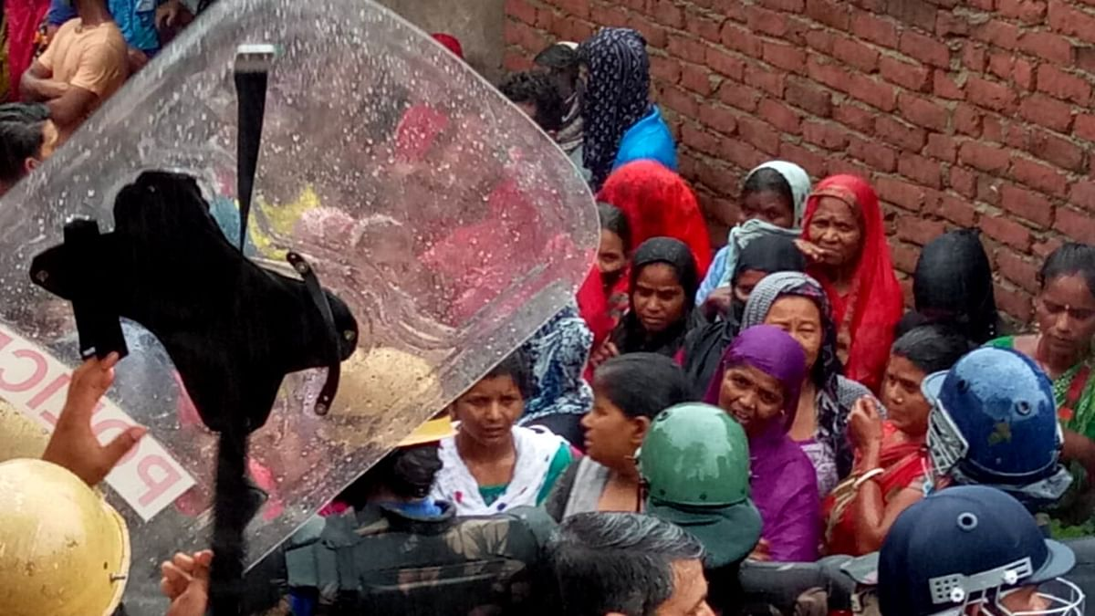 """<div class=""""paragraphs""""><p>Amid heavy police deployment, villagers continue to protest the demolition.</p></div>"""