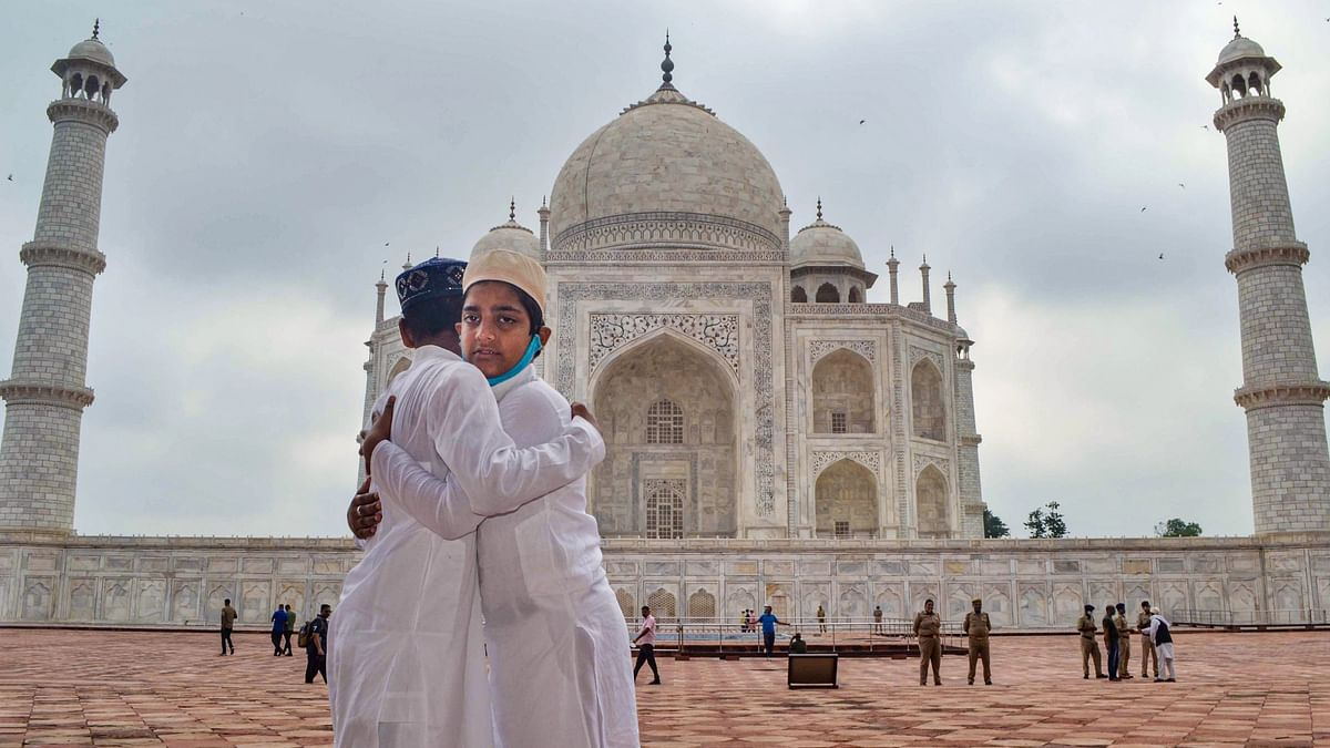 """<div class=""""paragraphs""""><p>Muslim children greet each other on the occasion of Eid al-Adha, at Taj Mahal complex, in Agra, Wednesday, 21 July.</p></div>"""