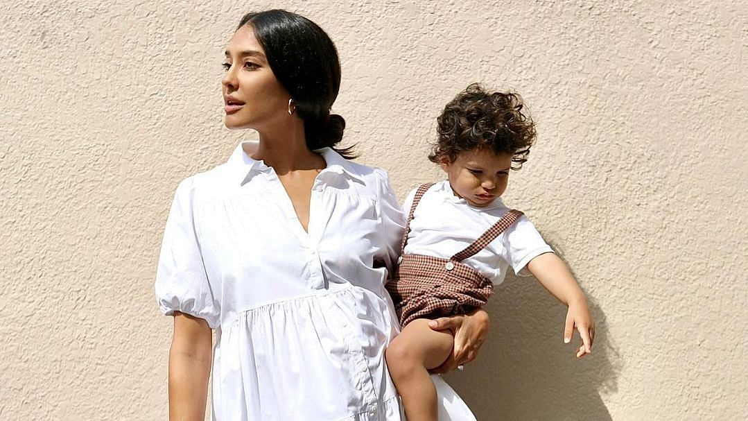 """<div class=""""paragraphs""""><p>Lisa Haydon with her son.</p></div>"""