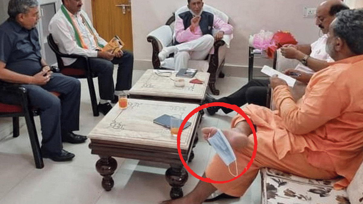 """<div class=""""paragraphs""""><p>Swami Yatishwaranand with his mask on his toe.</p></div>"""