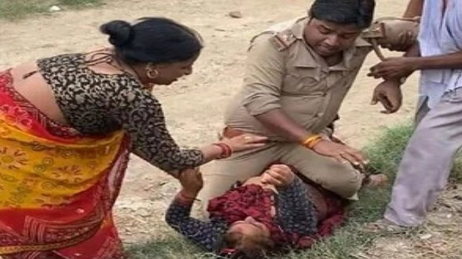 """<div class=""""paragraphs""""><p>UP Cop allegedly overpowered a woman and hit her as he sat on top of her in Kanpur.</p></div>"""