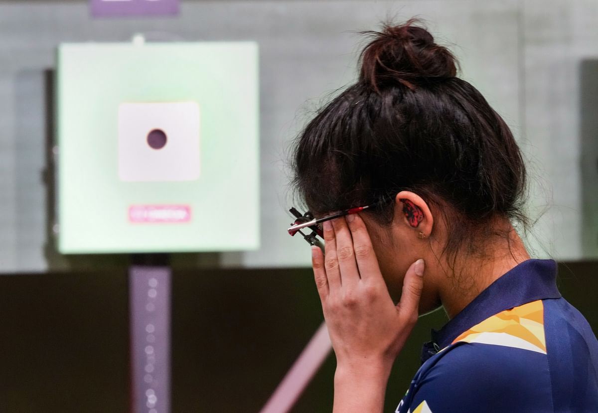 """<div class=""""paragraphs""""><p>India's Manu Bhaker reacts during the 10m Air Pistol Mixed Team shooting event, at the Summer Olympics 2020, in Tokyo, Tuesday, July 27, 2021. </p></div>"""
