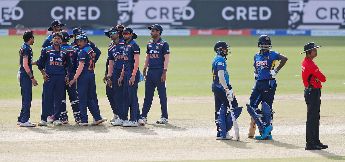 """<div class=""""paragraphs""""><p>India's bowler Kuldeep Yadav, second left, with his teammates waiting for a third umpire decision against Sri Lanka's Bhanuka Rajapaksa, third right, during the first one day international cricket match between Sri Lanka and India in Colombo, Sri Lanka, Sunday, July 18, 2021.</p></div>"""