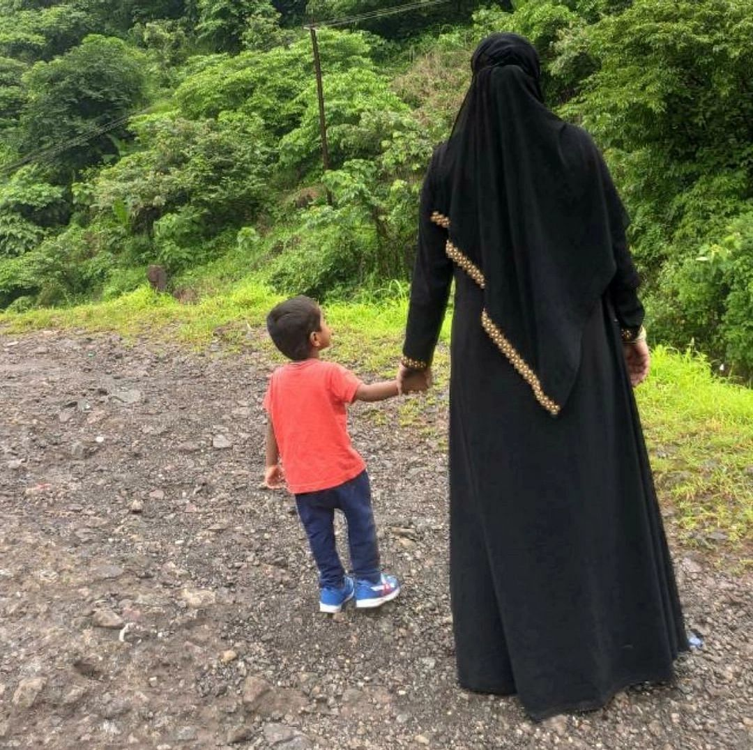 """<div class=""""paragraphs""""><p>Jannat is against revealing how she looks to the world. """"You can take this photo,""""she says. This is her and her son.</p></div>"""
