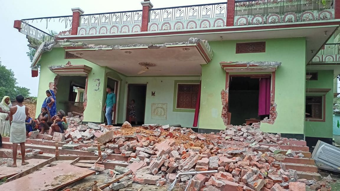 """<div class=""""paragraphs""""><p>Protesting women, most of them from the Dalit community have alleged that a posse of policemen arrived on the night of 29 June, partially bulldozed three houses, vandalised and ransacked furniture and household items, looted, and assaulted women and children in the house.</p></div>"""