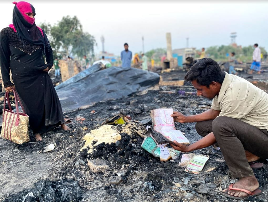 """<div class=""""paragraphs""""><p>Remnants of school books, destroyed in the Rohingya camp fire on 12 June.&nbsp;</p></div>"""