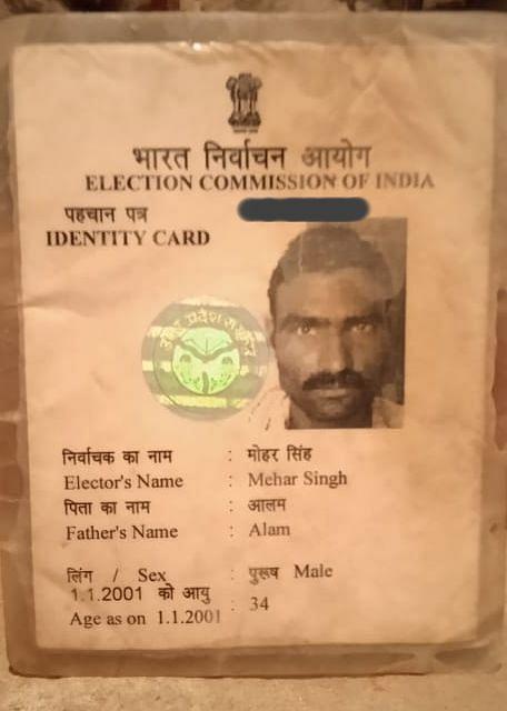 "<div class=""paragraphs""><p>Tasleem's father's voter ID card.</p></div>"