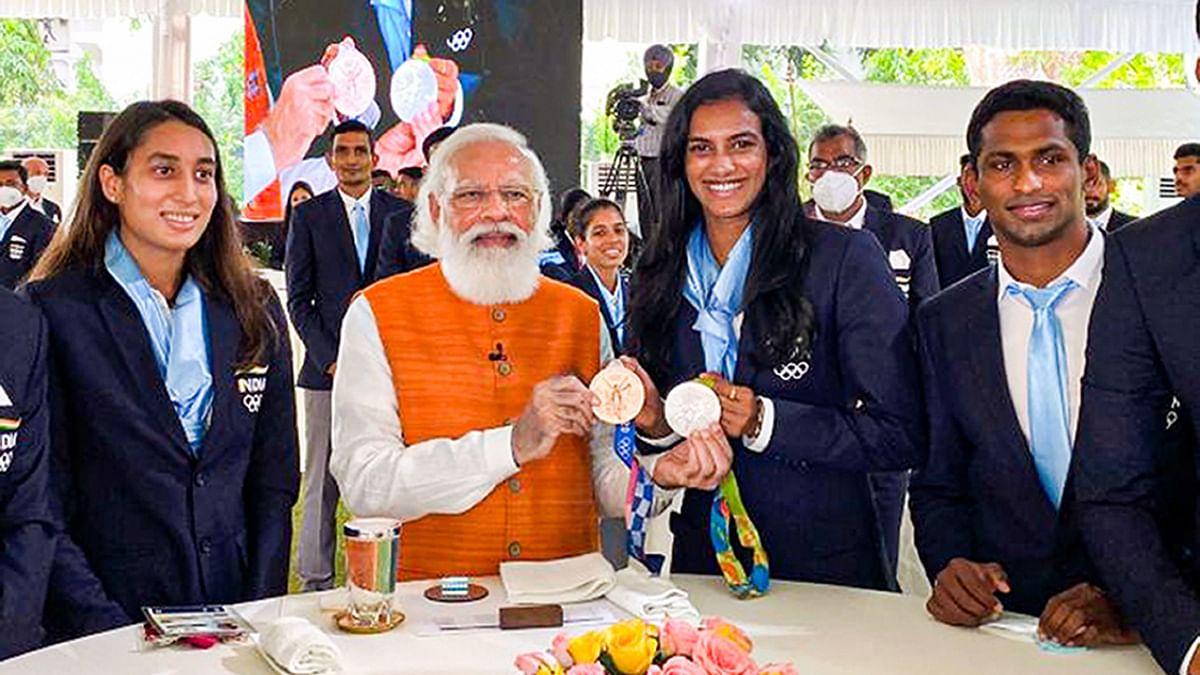 "<div class=""paragraphs""><p>PV Sindhu with PM Modi.</p></div>"