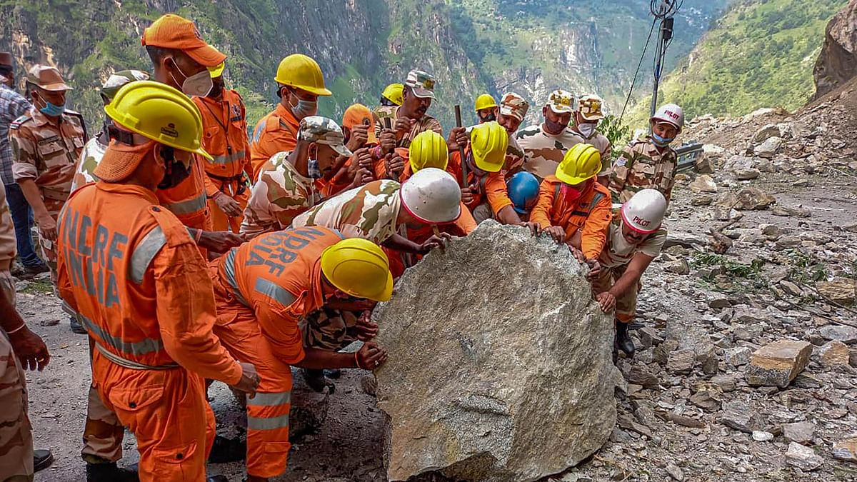"""<div class=""""paragraphs""""><p>National Disaster Response Force (NDRF) team during a rescue operation at the site of a landslide in Kinnaur district, Himachal Pradesh, on Wednesday, 11 August.</p></div>"""