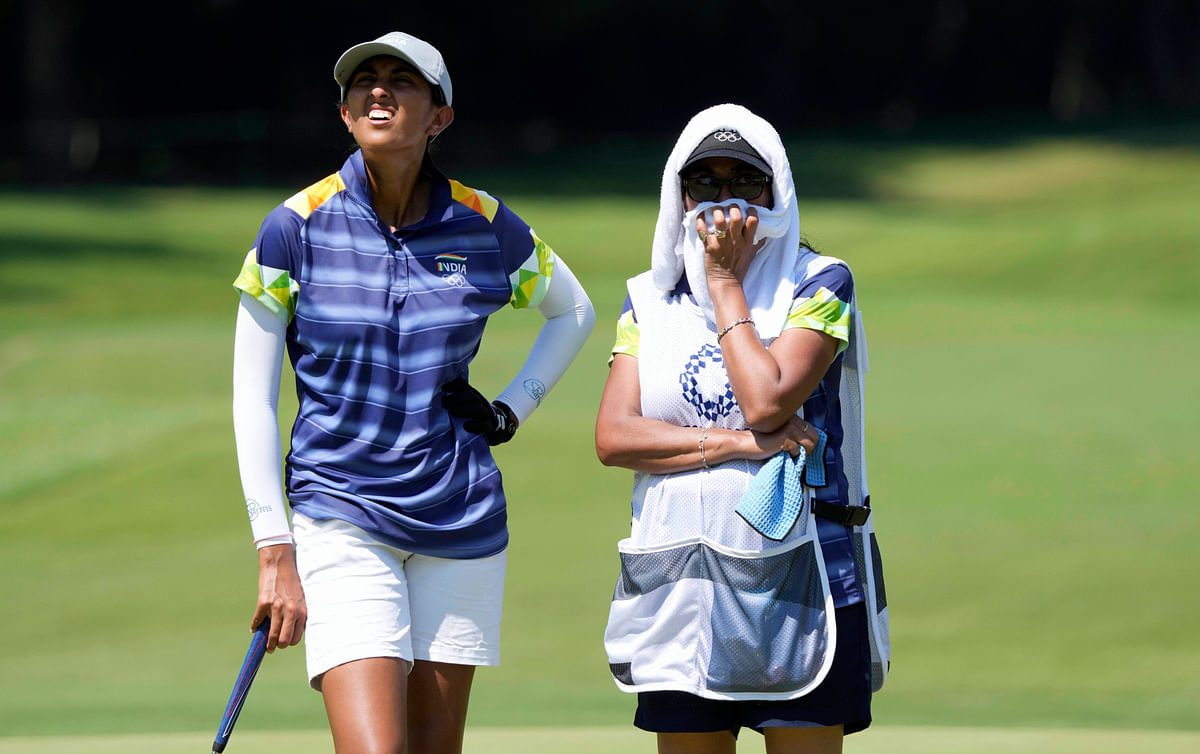 """<div class=""""paragraphs""""><p>Aditi Ashok is being caddied by her mother at the 2020 Tokyo Olympics.</p></div>"""