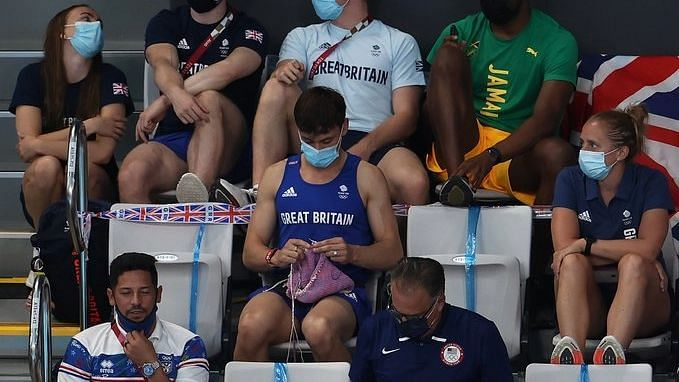 """<div class=""""paragraphs""""><p>Tokyo Olympics: Great Britain's Tom Daley knitting on Sunday in the stands.&nbsp;</p></div>"""