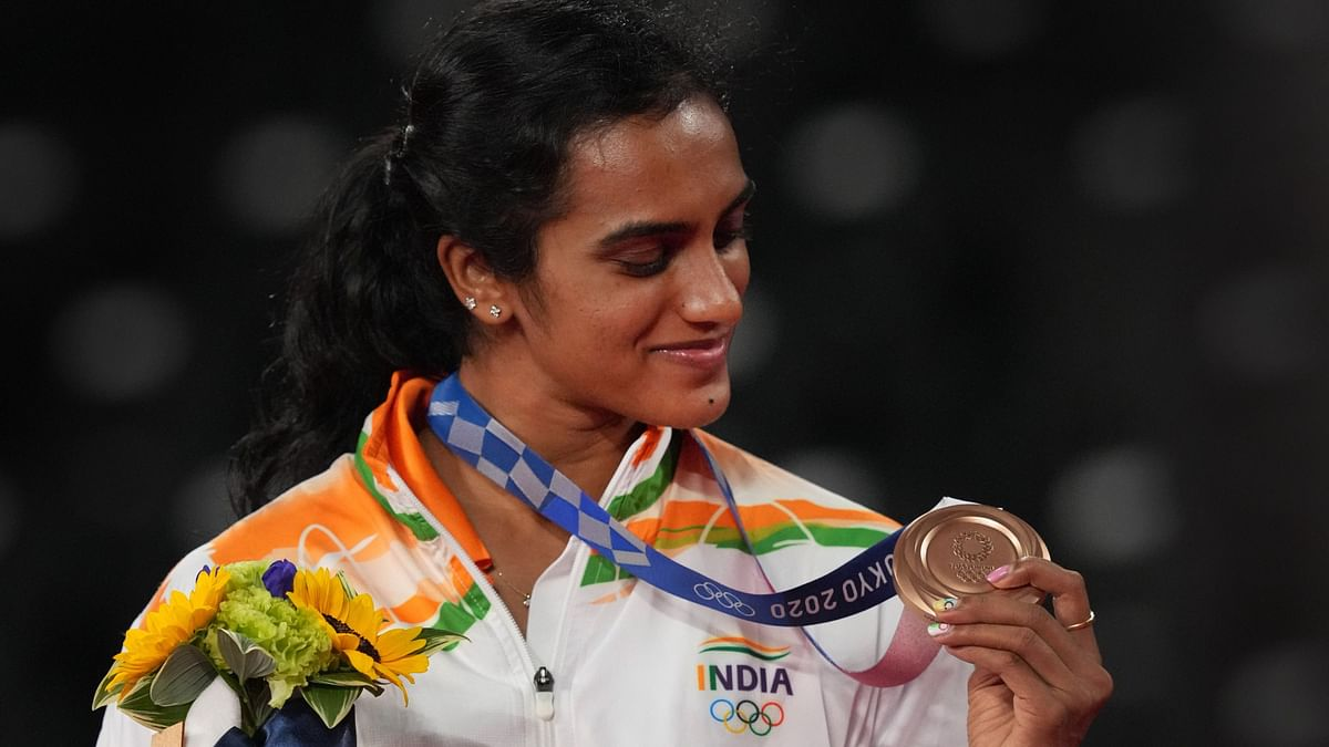 """<div class=""""paragraphs""""><p>PV Sindhu with the Bronze medal at the Tokyo Olympics</p></div>"""
