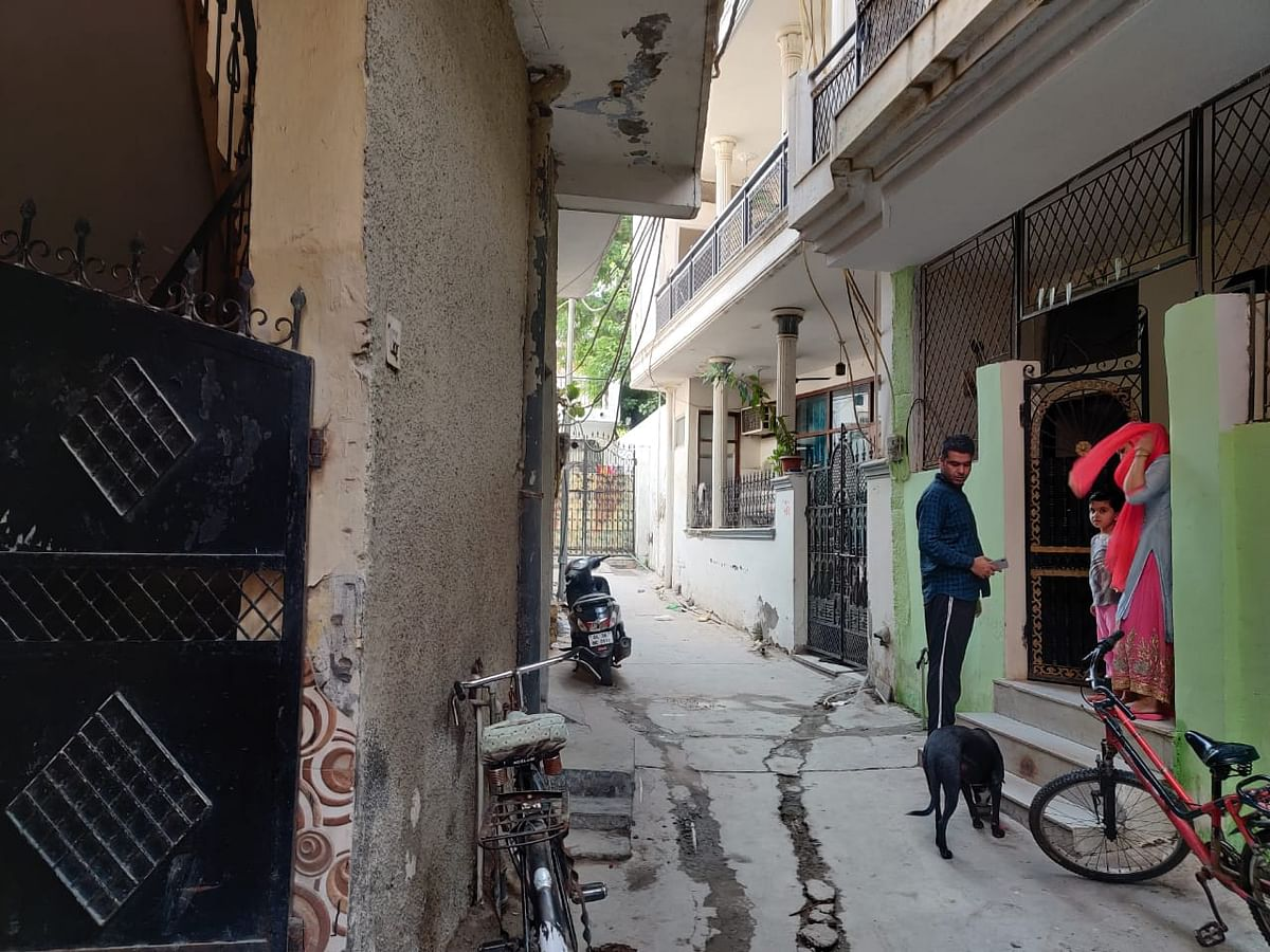 """<div class=""""paragraphs""""><p>That is Bhola standing outside his home, right adjacent to the home of the accused.</p></div>"""