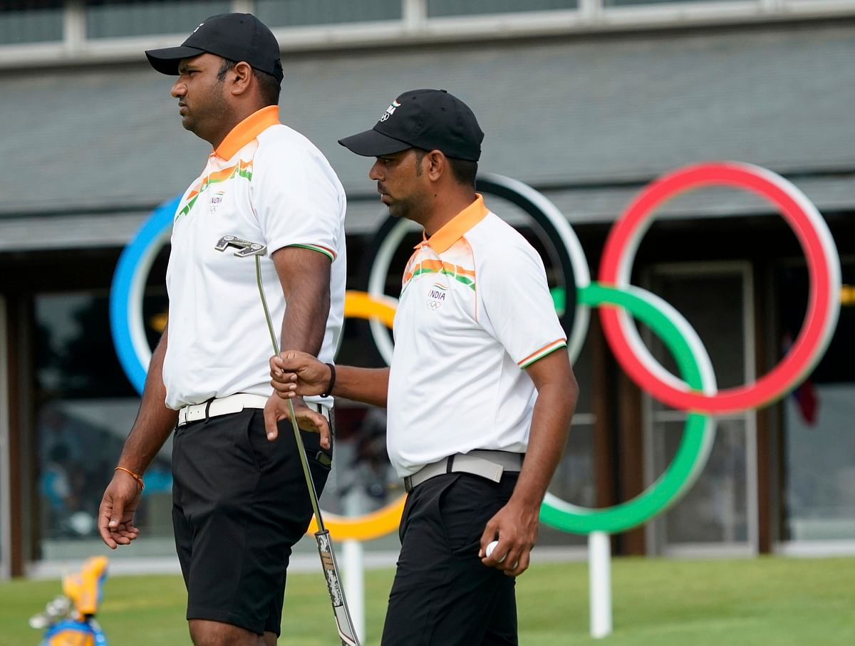 """<div class=""""paragraphs""""><p>India's Udayan Mane, left, and his teammate Anirban Lahiri at the putting green during a practice session of the men's golf event at the 2020 Tokyo Olympics.</p></div>"""
