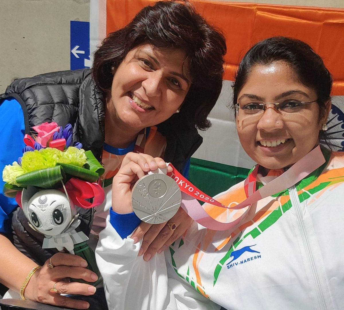 """<div class=""""paragraphs""""><p>Paralympic Committee of India chief Deepa Malik (L) with paddler Bhavina Patel (R) as she won a Silver medal in Women's Singles Class 4 event at Paralympics Tokyo 2020.</p></div>"""