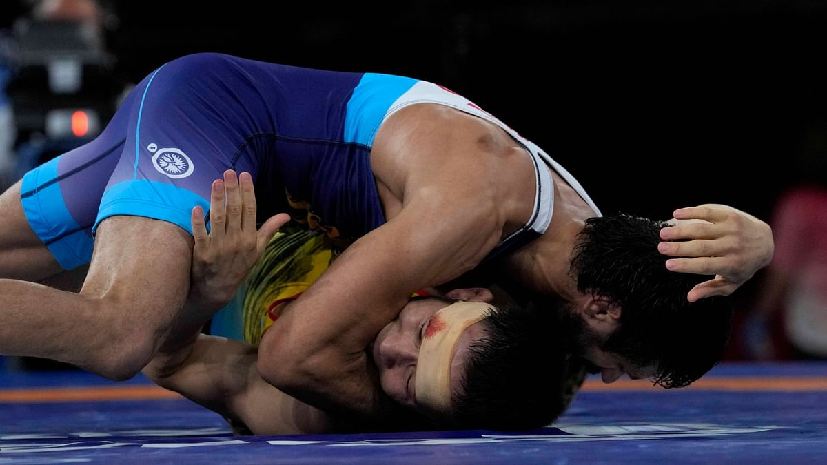 """<div class=""""paragraphs""""><p>Ravi Kumar Dahiya (in blue) was bitten by his opponent in his match on Wednesday.&nbsp;</p></div>"""