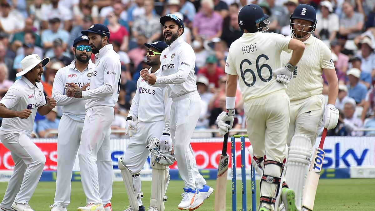 """<div class=""""paragraphs""""><p>India celebrate the wicket of Jonny Bairstow in the first Test.</p></div>"""