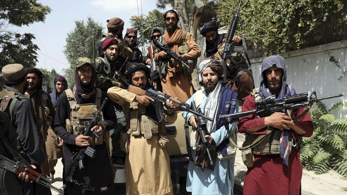 """<div class=""""paragraphs""""><p>Taliban fighters pose for a photograph in Kabul, Afghanistan, on 19 August. Image used for representational purposes.</p></div>"""