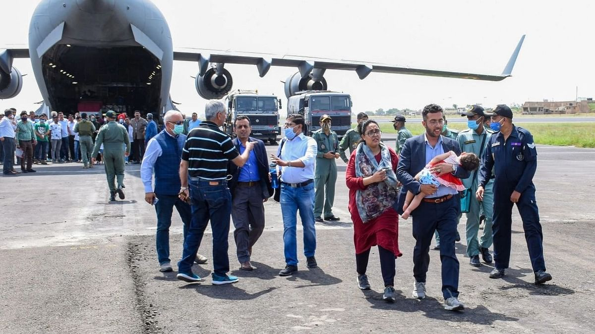"""<div class=""""paragraphs""""><p>Government officials welcome Indian citizens on their arrival from Afghanistan by an Indian Air Forces C-17 aircraft, in Jamnagar on 17 August.</p></div>"""