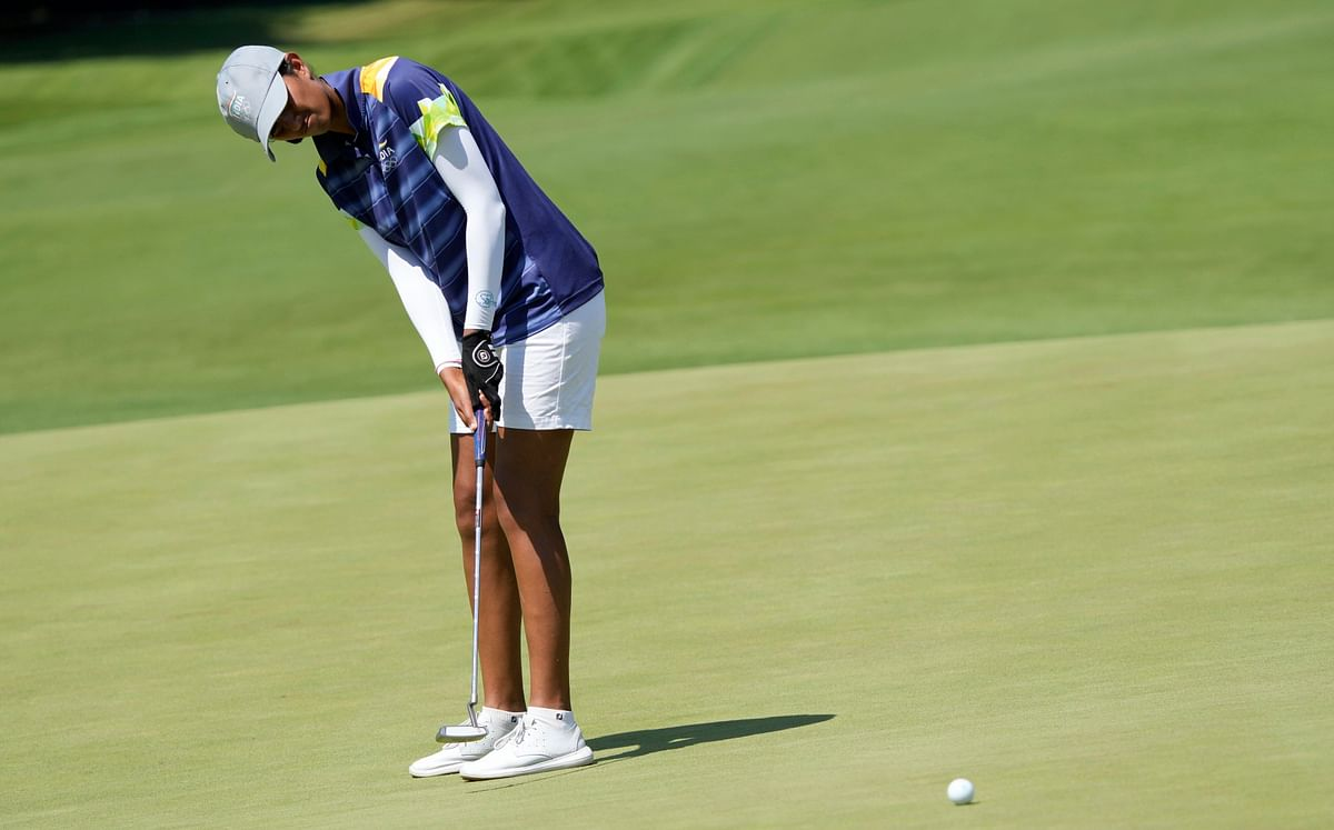 """<div class=""""paragraphs""""><p>Aditi Ashok, of India, makes a putt on the 15th hole during the first round of the women's golf event at the 2020 Summer Olympics, Wednesday</p></div>"""