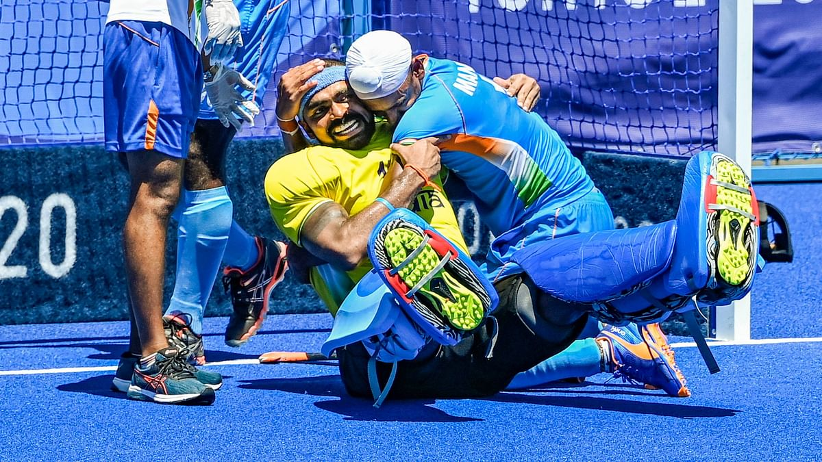 """<div class=""""paragraphs""""><p>National Hero: PR Sreejesh celebrates with Mandeep Singh after India beat Germany 5-4 to win the Bronze medal after 49 years.&nbsp;</p></div>"""