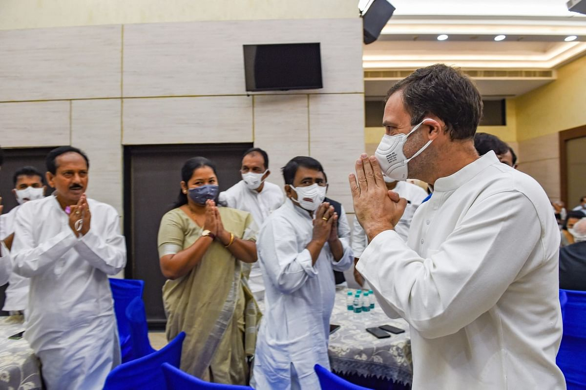"""<div class=""""paragraphs""""><p> Congress leader Rahul Gandhi greets Opposition leaders during a breakfast meeting at the Constitution Club in  Delhi.<br></p></div><div class=""""paragraphs""""><p><br></p></div>"""