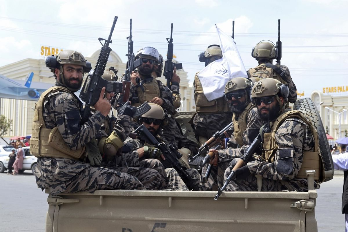 """<div class=""""paragraphs""""><p> Taliban special force fighters arrive to the Hamid Karzai International Airport after the US militarys withdrawal, in Kabul, Afghanistan.</p></div>"""