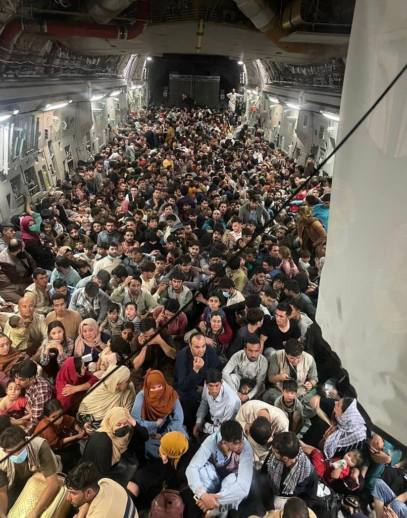An Extraordinary Image: Hundreds of Fleeing Afghans Board US Military Plane