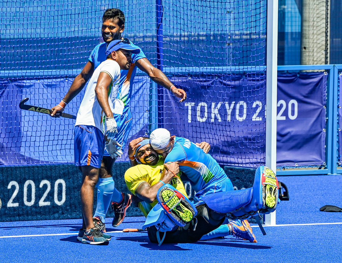 """<div class=""""paragraphs""""><p>India's Sreejesh and Mandeep hug each other as they celebrate their victory over Germany in the men's field hockey bronze medal match at the Tokyo Olympics.</p></div>"""