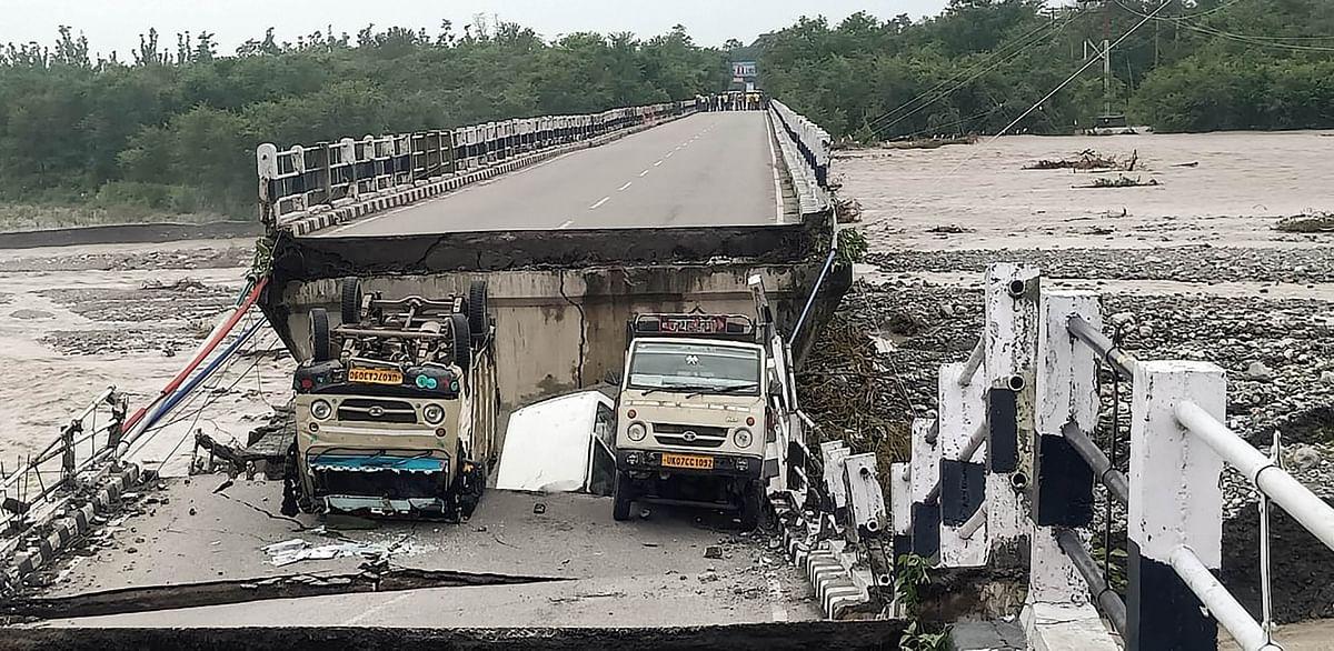 "<div class=""paragraphs""><p>Dehradun: A view of the collapsed Rani Pokhari bridge on Dehradun-Rishikesh highway after heavy rain, near Dehradun, Friday, 27&nbsp;August 2021</p></div>"