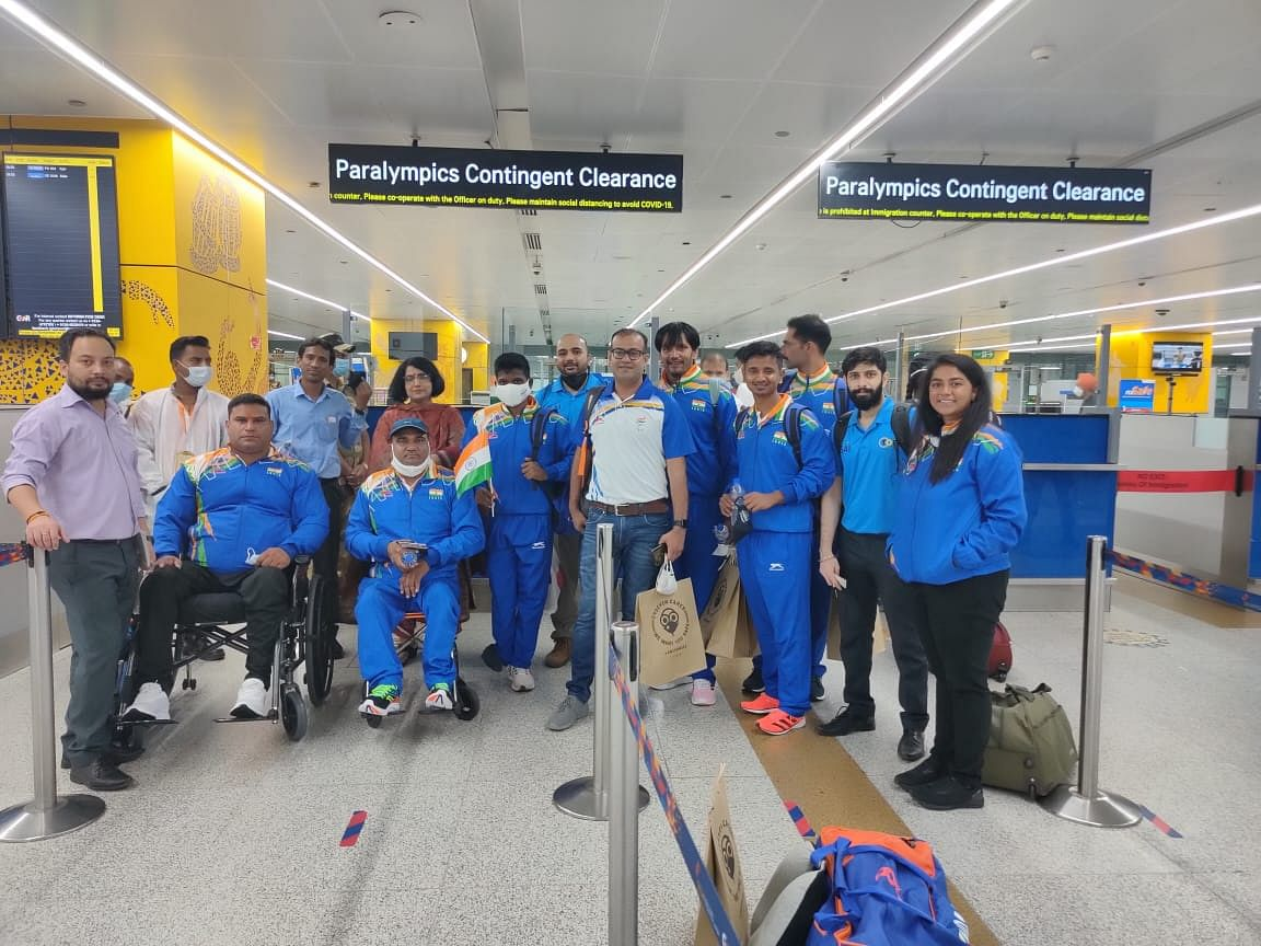 """<div class=""""paragraphs""""><p>Indian Paralympians and support staff pose for a photo at the Indira Gandhi International Airport in Delhi early on Wednesday morning.&nbsp;</p></div>"""