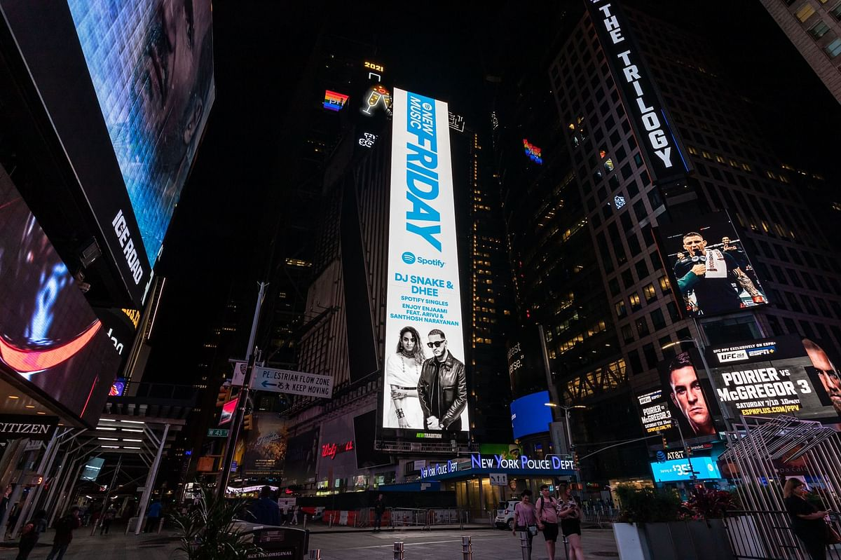 """<div class=""""paragraphs""""><p>The Times Square banner had no picture of Arivu.</p></div>"""