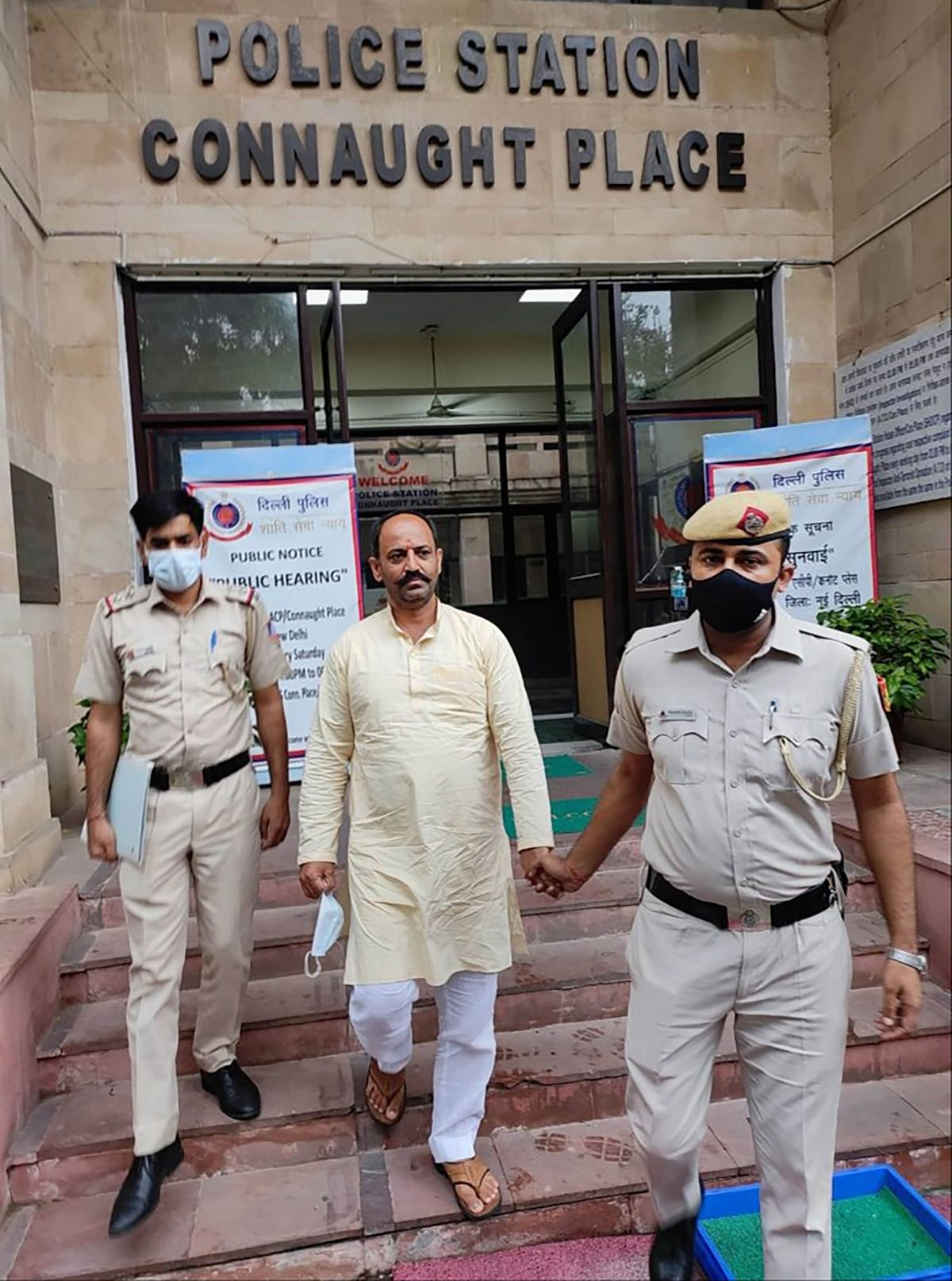 """<div class=""""paragraphs""""><p>New Delhi: Delhi Police personnel with Hindu Raksha Dal leader Pinki Chaudhary, arrested in connection with communal sloganeering at Jantar Mantar during a protest, in New Delhi<br></p></div>"""