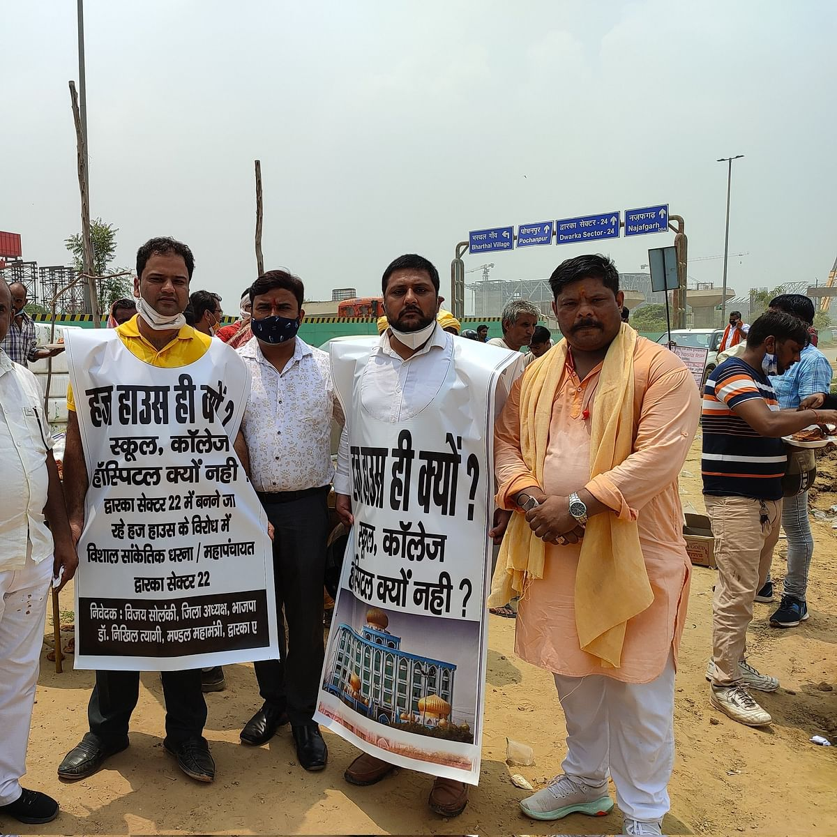 """<div class=""""paragraphs""""><p>Here Aazad Vinod (right most) is present at the protest against setting up a Hajj house in Dwarka.</p></div>"""