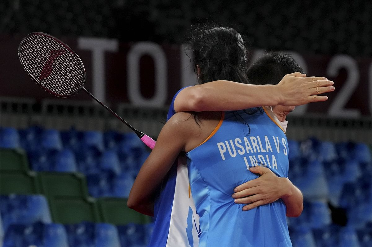 """<div class=""""paragraphs""""><p>Tokyo: India's Pusarla V. Sindhu hugs her opponent after her women's singles badminton bronze medal match against China's He Bingjiao, at the 2020 Summer Olympics, in Tokyo, Sunday, Aug. 1, 2021. </p></div>"""