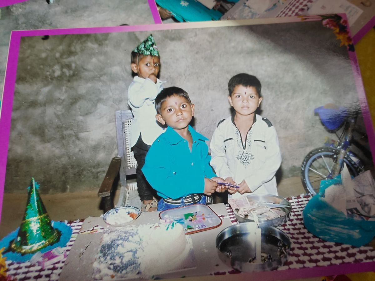 """<div class=""""paragraphs""""><p>A photograph from Ashok's son's birthday some years ago.</p></div>"""