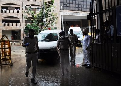 """<div class=""""paragraphs""""><p>New Delhi: Ambulance carrying dead bodies from Rohini court in New Delhi, on Friday, September 24, 2021. The shooting took place as Jitendra Gogi, who was facing murder and extortion charges, entered the courtroom.</p></div>"""