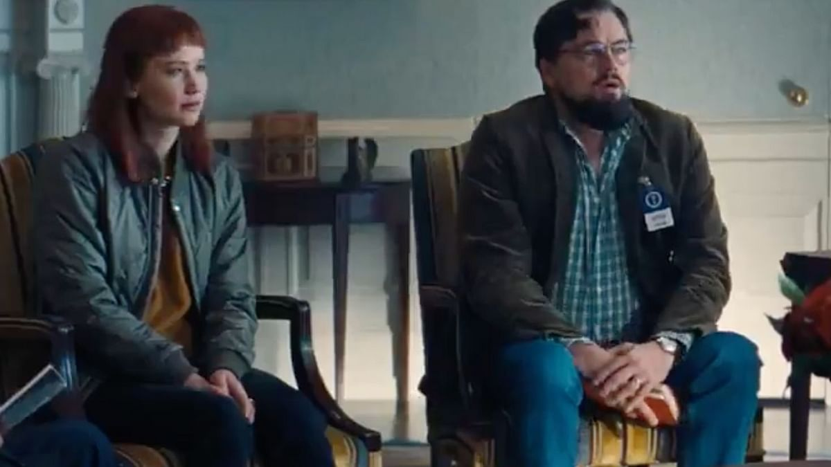"""<div class=""""paragraphs""""><p>Leonardo DiCaprio and Jennifer Lawrence in a still from <em>Don't Look Up</em>.</p></div>"""