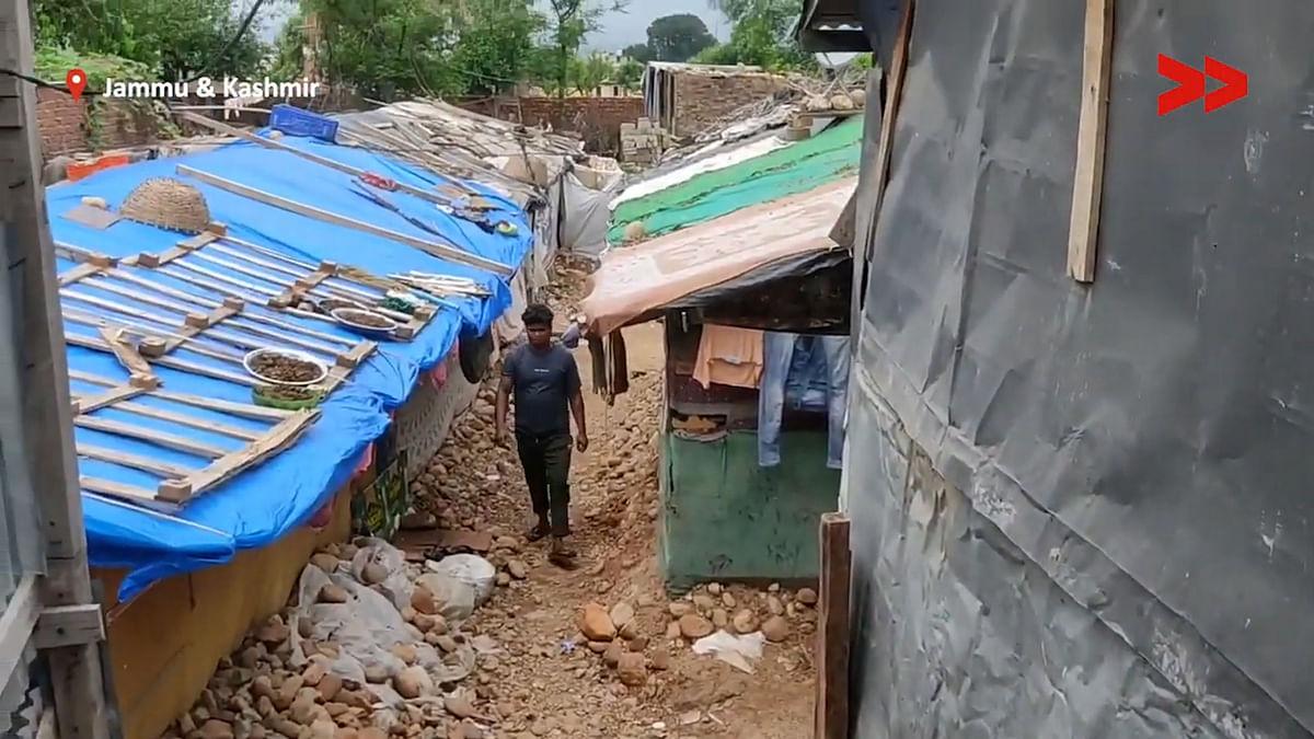 "<div class=""paragraphs""><p>A Rohingya refugee walks through a narrow lane in the colony.</p></div>"