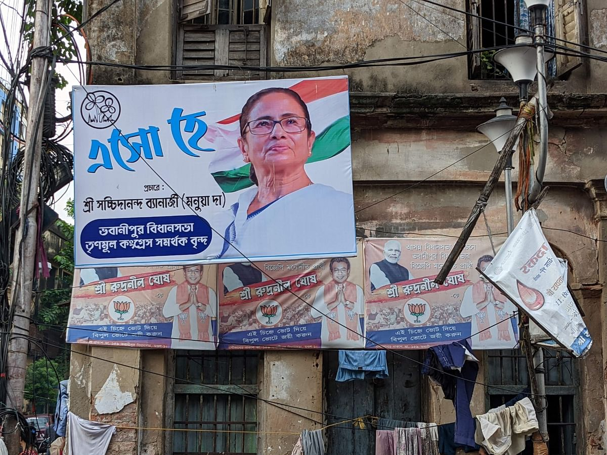 """<div class=""""paragraphs""""><p>A poster of Mamata Banerjee in Bhabanipur. Underneath, one can see torn down posters of Rudranil Ghosh, BJP's candidate from Bhabanipur in the last election.</p></div>"""
