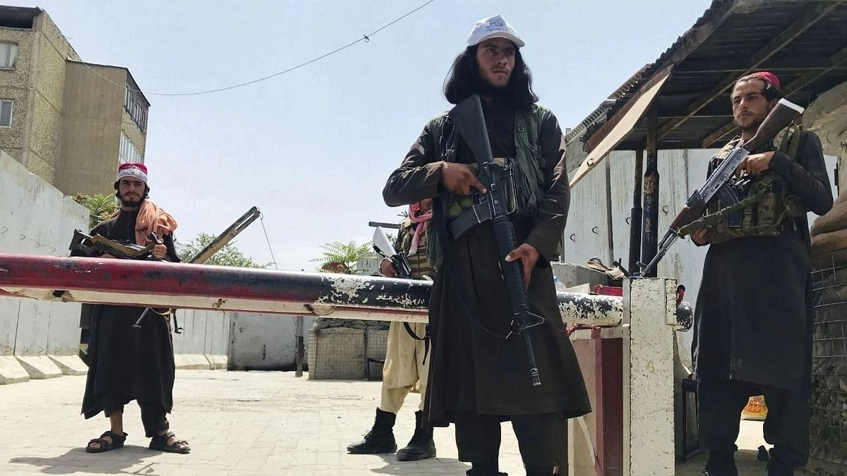 """<div class=""""paragraphs""""><p>Taliban fighters stand guard at a checkpoint near the US embassy. Image used for representational purpose.</p></div>"""
