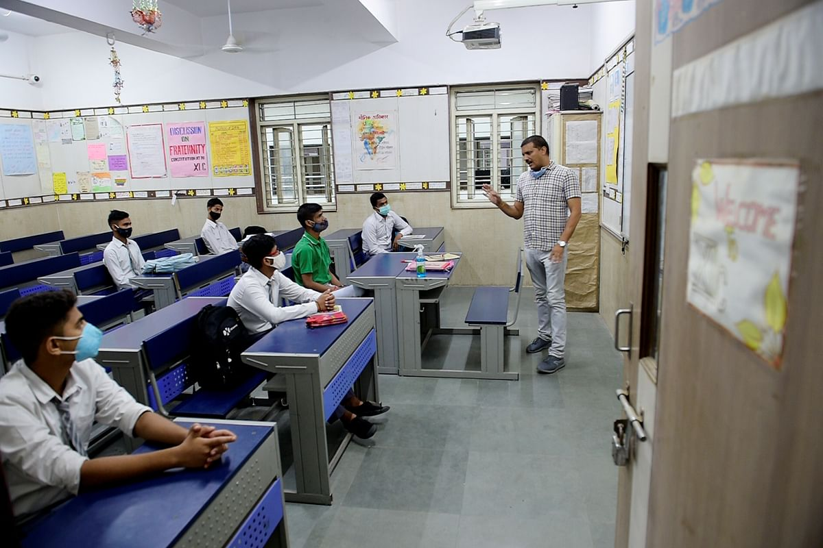 """<div class=""""paragraphs""""><p>Students attend a class at the Sarvodaya Bal Vidyalaya, Rouse Avenue which reopened after further ease in COVID-19 restrictions, in New Delhi, Wednesday, 1 September, 2021.</p></div>"""