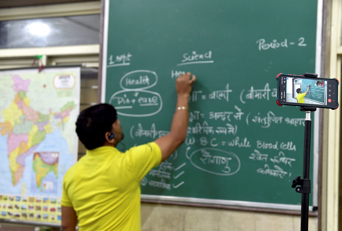 """<div class=""""paragraphs""""><p>A teacher takes a class at the Sarvodaya Bal Vidyalaya, Rouse Avenue which reopened after further ease in COVID-19 restrictions, in New Delhi.</p></div>"""