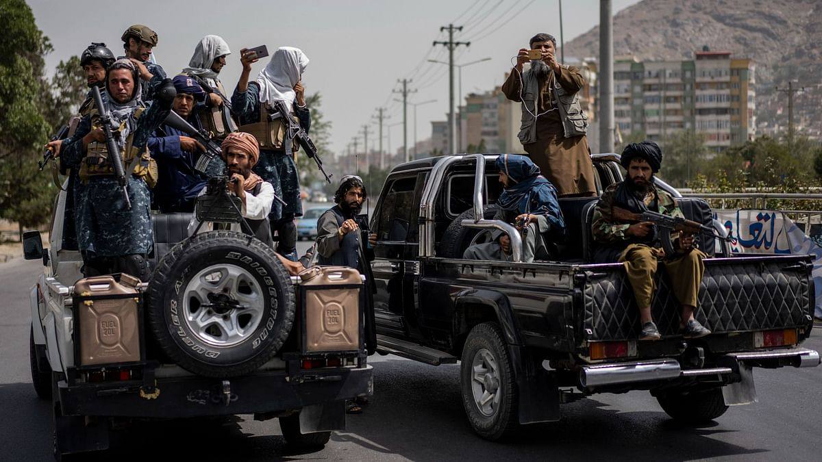 """<div class=""""paragraphs""""><p>Taliban fighters outside Kabul University on Saturday, 11 September. </p></div>"""