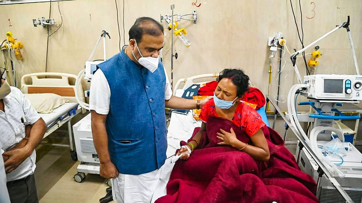 """<div class=""""paragraphs""""><p> Assam Chief Minister Himanta Biswa Sarma interacts with a survivor of the boat accident at Jorhat Medical College &amp; Hospital on Thursday.<br></p></div>"""