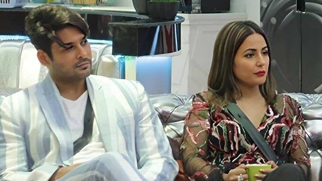 """<div class=""""paragraphs""""><p>Sidharth Shukla with Hina Khan inside a&nbsp;<em>Bigg Boss&nbsp;</em>house.</p></div>"""