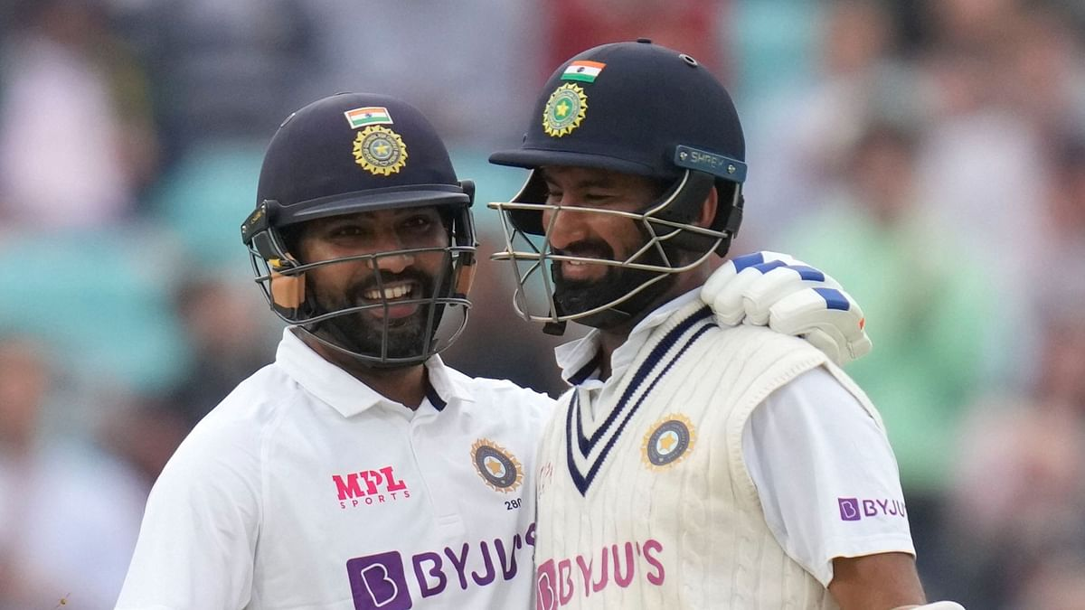 """<div class=""""paragraphs""""><p>India's Rohit Sharma celebrates scoring 100 runs with Cheteshwar Pujara on day three of the fourth Test at The Oval.</p></div>"""