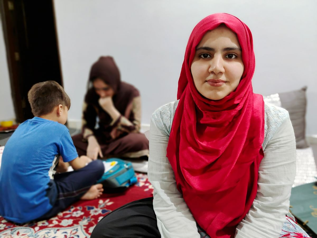"""<div class=""""paragraphs""""><p>Twenty-year-old Muzhda Qadir's lives with her two sisters, brother and mother. Her sister Adina is tutoring a neighbourhood kid in the background. This is one of their primary sources of income now.</p></div>"""