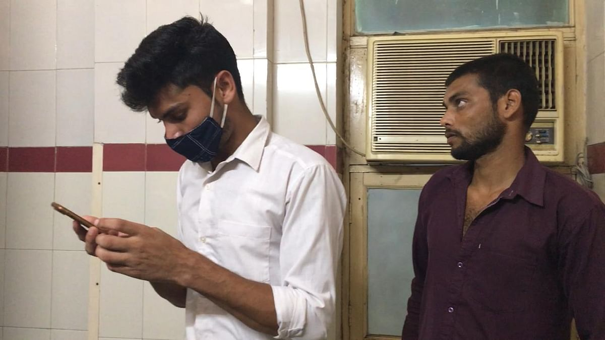 """<div class=""""paragraphs""""><p>Akshay (on the left) and Akash Kumar in the hospital as they wait to be allowed to get a glimpse of Daksh again.</p></div>"""