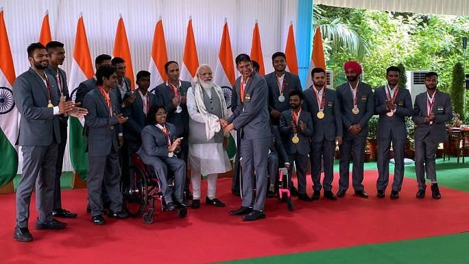 """<div class=""""paragraphs""""><p>PM Modi receives a gift from the Indian Tokyo Paralympic contingent.&nbsp;</p></div>"""